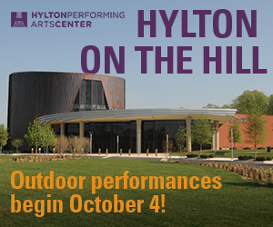 "A large auditorium on top of a hill, text reading: ""Hylton On The Hill; Outdoor performances begin October 4!"""