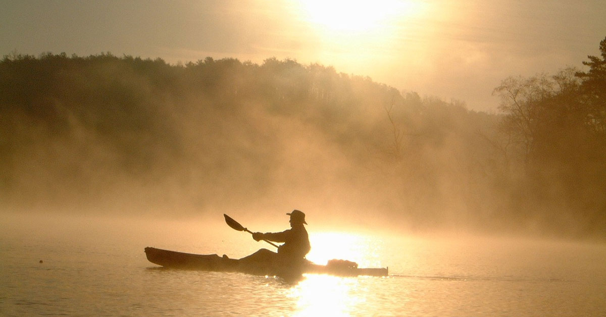 Kayaker in the mist