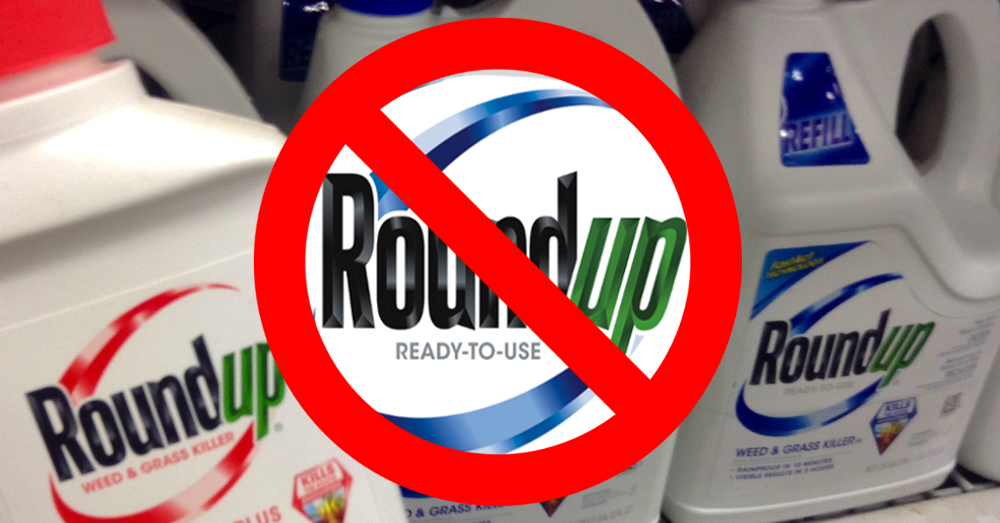 Monsanto Roundup bottles with a red line throgh