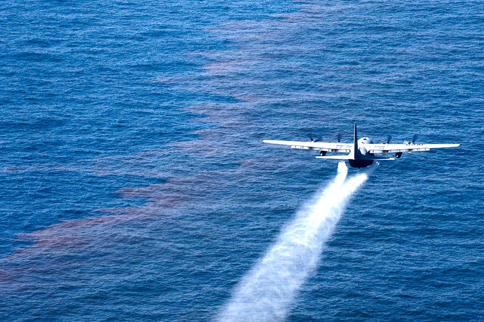 photo of a plane spraying over the sea