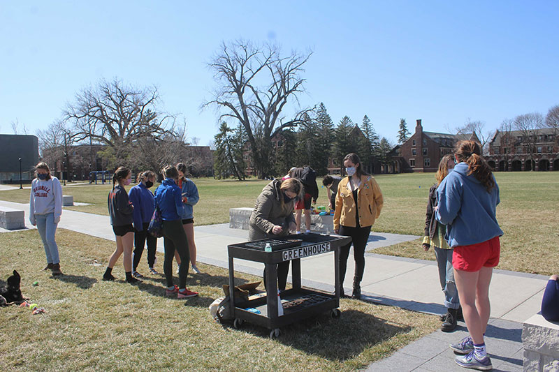 photo of young people on a campus outdoors